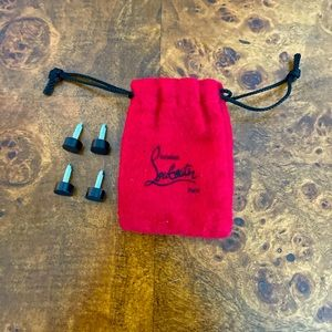 Authentic Christian Louboutin pouch and heel taps